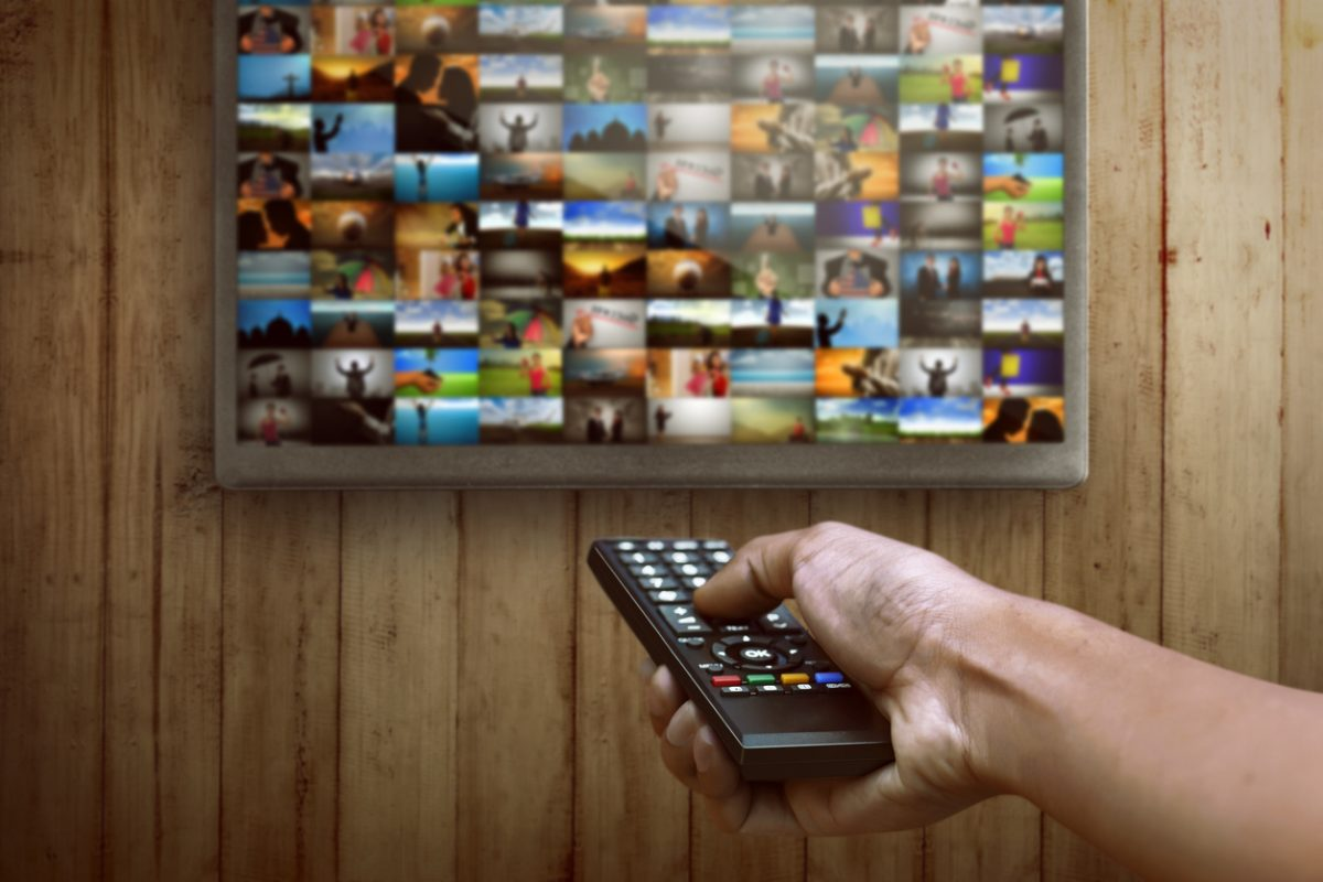 Man choosing channel on the smart tv what to watching