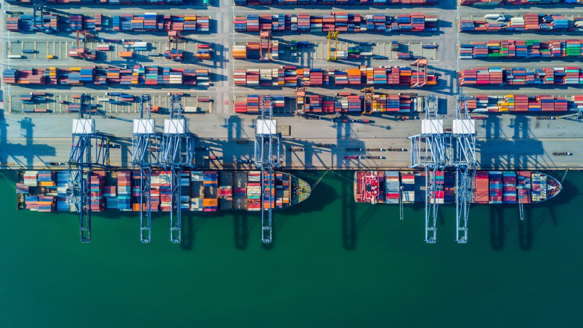 Aerial view from drone, container ship in import export and business logistic by craneAerial view from drone, container ship in import export and business logistic by crane